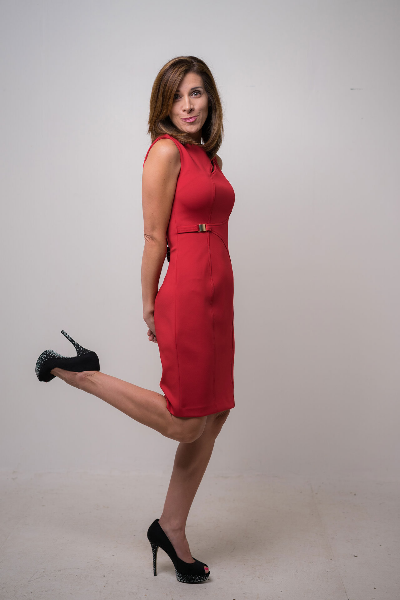 Blanca Cobb, body language expert, cute pose in red dress